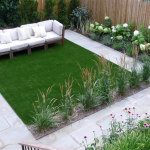 Small garden with fake grass and native plants