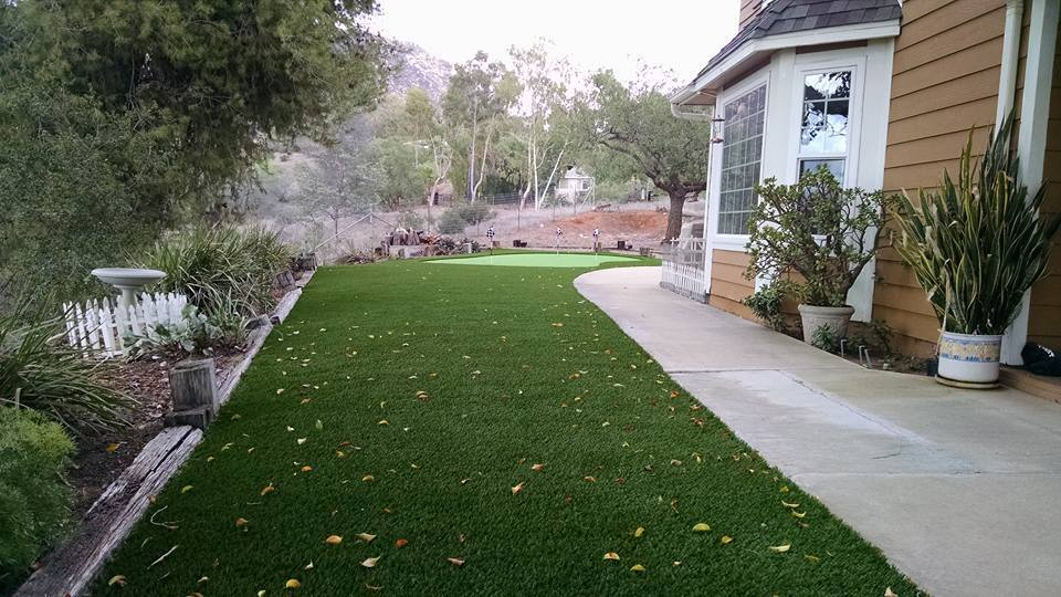 Lush green fake grass lawn